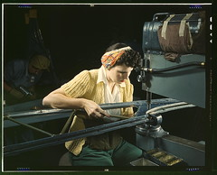 "A girl riveting machine operator at the Douglas Aircraft Company plant joins sections of wing ribs to reinforce the inner wing assemblies of B-17F heavy bombers, Long Beach, Calif. Better known as the ""Flying Fortress,"" the B-17F bomber is a later model o (The Library of Congress) Tags: woman industry yellow vintage sweater wings women october factory rosietheriveter aircraft labor wwii working knit slidefilm nostalgia worldwarii longbeach 1940s transparency ww2 4x5 lf libraryofcongress 1942 flyingfortress largeformat operator longbeachca worldwar2 wartime rivet transparencies riveter assemblyline calfornia concentrating kerchief drillpress riveting historicalphotographs femaleworker b17f wareffort xmlns:dc=httppurlorgdcelements11 douglasaircraftcompany october1942 dc:identifier=httphdllocgovlocpnpfsac1a35336 alfredtpalmer alfredpalmer"