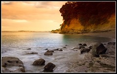 Sunset Beach (Chris Gin) Tags: longexposure sunset newzealand beach water rocks auckland nz beaches soe firstquality platinumphoto aplusphoto superbmasterpiece diamondclassphotographer brillianteyejewel worldwidelandscapes