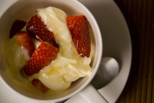 Greek yoghurt with strawberries drizzled with honey