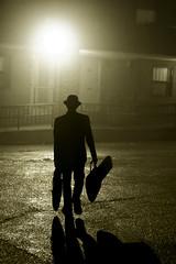 rock and roll (richietown) Tags: light shadow blackandwhite bw musician mist man topf25 silhouette topv111 boston misty fog canon topv333 shadows guitar massachusetts foggy guitars backlit 30d 50mm18 bostonist longshadow patrickdunn richietown wwwpatrickdunnmusiccom