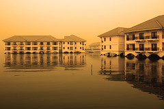 Intercontinental Hotel - Hanoi 3 (Life in AsiaNZ) Tags: lake west building water sepia architecture canon reflections hotel g floating powershot vietnam fv10 series hotels hanoi 5star intercontinental   g9 gseries  canong9 lifeinnanning flickrgiants