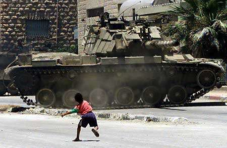 boy throw rock at tank