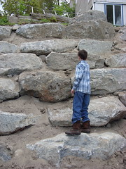 Peter scales the new stone wall.