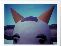 Odio il tedio all'Hotel Clodio_____Ferrara Balloons Festival (Ilaria ♠) Tags: polaroid toycamera ferrara milka mucca viola cioccolato corna 669 baloonfestival colorpackii toycamerafotografiaanalogicaitalia type100film