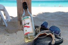 hey... where's all my rum?! (lynn.h.armstrong) Tags: ocean camera blue red vacation people brown sun white ontario canada reflection art water sunglasses azul lens geotagged photography photo bottle interesting mac sand chair aperture nikon long flickr post zoom bokeh sandals empty south lounge cuba may pole lynn h shade rum iberostar laguna nikkor varadero armstrong stormont vr afs gettyimages dx sault ingleside 2011 ifed 18200mm f3556 attributionnoderivs vrii cubay d7000 ccbynd lynnharmstrong requesttolicence