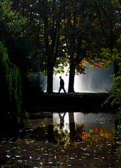 Lone figure caught in fountain's light! (James Rainsford) Tags: autumn light green water fountain amsterdam figure relection lonely smorgasboard amazingtalent flickrsbest anawesomeshot colourartaward excapture worldphotodoc2007 ~~api~~