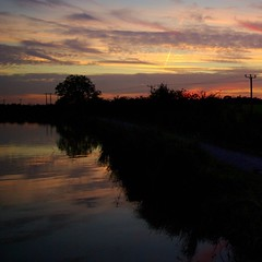Sells Green sunset (lovestruck.) Tags: sunset sky reflection water clouds evening canal wires wiltshire telephonewires kennetandavoncanal challengeyouwinner pentaxk10d sellsgreen