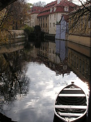 Sun Reflection Covered by a Boat on Mal Strana, Prague (Istvan) Tags: mill water boat prague olympus c740 wysiwyg blueribbonwinner mywinners abigfave colorphotoaward diamondclassphotographer flickrdiamond ysplix worldwidelandscapes