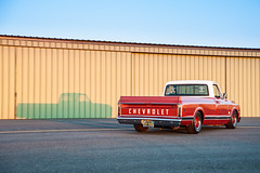 Chevy C-10 (nophoto4jojo) Tags: activeassignmentweekly chevy c10 pickup truck orange white personalized plates sunset airport hangar road drive lines nikon d700 lightroom