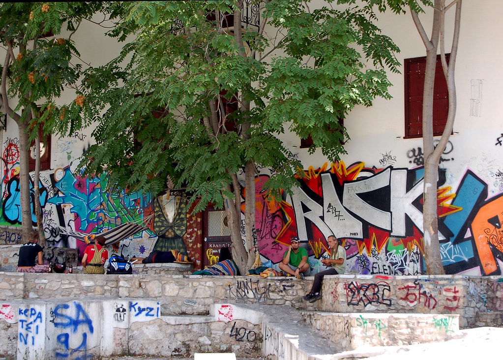 "Ancient history, a graffiti decor and ""hammock-ready"" trees distinguish this oasis for the Athenian homeless."