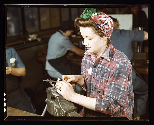 One of the girls of Vilter [Manufacturing] Co. filing small gun parts, Milwaukee, Wisc. One brother in Coast Guard, one going to Army. (LOC) by The Library of Congress.
