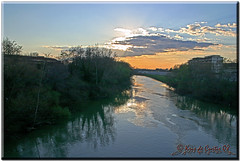 Along the River (krisdecurtis) Tags: sunset sky italy panorama sun backlight clouds canon reflections river spectacular landscape interestingness italia 300d cityscape campania canon300d fiume dream kris 2008 paesaggio controluce masterpiece capua marvels volturno maddaloni meraviglie viewfromabridge krisdecurtis superaplus aplusphoto betterthangood imherehimyfriend