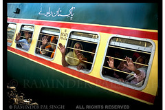 Train To Pakistan (Raminder Pal Singh) Tags: pakistan red people india train happy hands bars d70 nikond70 brothers anniversary faith joy belief wave fraternity journey farewell devotion sikhs homage celebrate pilgrimage guru urdu raminder theperfectphotographer
