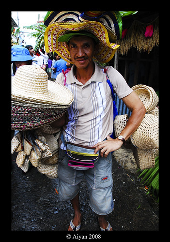 Lucban Quezon Pahiyas festival hat vendor poses for a picture street peddler  Buhay Pinoy Philippines Filipino Pilipino  people pictures photos life Philippinen