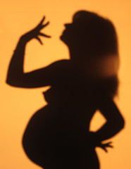 Big news is comin' (Nicola Troccoli) Tags: life light shadow orange woman sun news silhouette wall twins pregnant pauline impressedbeauty