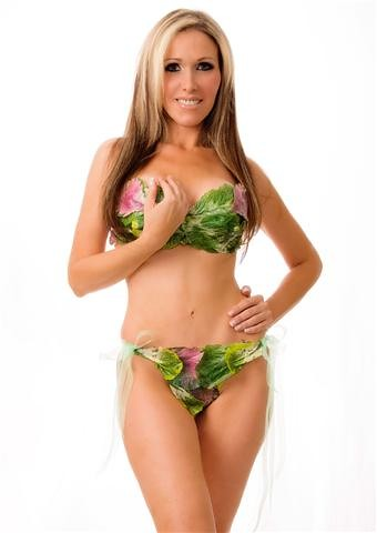 A woman wearing only lettuce posing for photo shoot of PETA