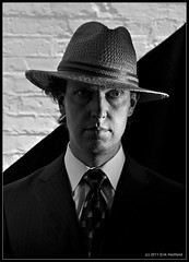 Film Noir (eriksweeklyphoto) Tags: portrait selfportrait hat grid nikon noir diagonal reflector filmnoir strobist nikond7000 strobistsundays