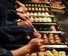 balls of fury in the making (AraiGodai) Tags: food japanese restaurant interesting olympus explore esplanade process making takoyaki octopusball gindaco araigordai ทาโกะยากิ wannaseeballsoffurymovie raigordai araigodai