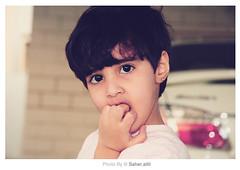 لا تطــالعني حبيبي بـ هالبرود .. تو حبك مشتعلني ما إنطفى } ,, (Nasser Bouhadoud) Tags: baby home girl car digital canon eos 350d rebel is 17 mm usm 85 efs nasser doha qatar 2007 saher f456 ناصر hajer xti allil saherallil hajjer بوحدود