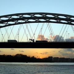 Under the bridge (Dappers) Tags: bridge blue light sunset sky sun cars water silhouette clouds river rotterdam trucks maas brienenoord dekuip brienenoordbrug