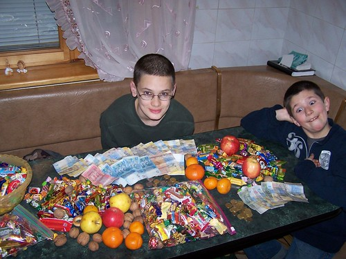 Dominic and Joshua looking over their haul of candy and money from Christmas caroling