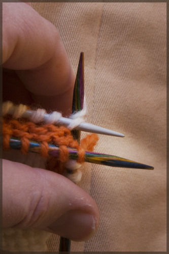Knit two stitches together: one from front needle, one from back needle