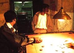Mens Playing, Women Working (Alessandro Dei) Tags: red india portraits indian prostitution figli kolkata ritratti ritratto calcutta sons hijos brothels sfruttamento sonagachi prostituzione districtborb