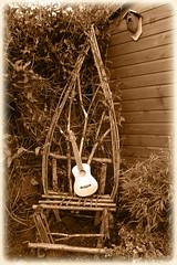 Uke seat (rackratchet) Tags: ukulele sepiatone gardenseat