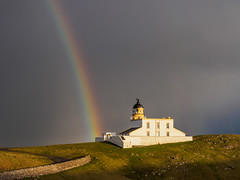 Rainbow Stoer (Highlandscape) Tags: stone lighthouse em5 building stoer head weather light httphighlandscapezenfoliocom seascapecategory cloud shower hail early morning scottishlandscapephotographeroftheyear olympus highlands iv274jh structure colour commended rainbow slpoty wind waves sky sea wall rain scotland white