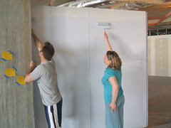 Adam and Alyson Painting a Wall