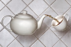 Bewitched Tea (TomOnTheRoof) Tags: morning white motion cup topf25 kitchen horizontal closeup ceramic tea magic surreal nopeople pot indoors kettle teapot conceptual teacup foodanddrink pouring refreshment bewitched tiled tomanthony clevercreativecaptures thememorning