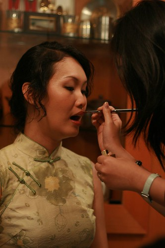 Eunice applying make-up on Kimmy