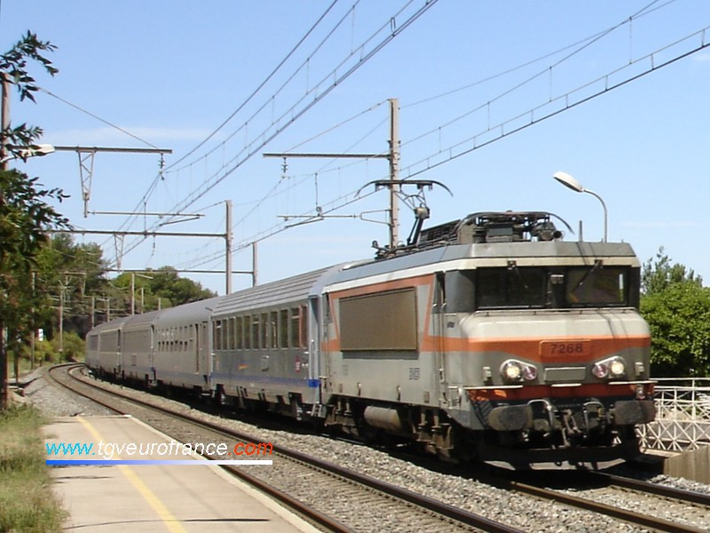 A BB 7200 SNCF electric locomotive crossing the Saint-Chamas station with a regional train to Marseille on August 2, 2006