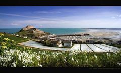 Mont Orgueil Castle - Jersey (jerseyimage) Tags: greatbritain sea color colour castle tourism beach field horizontal port canon outside outdoors coast spring day view britishisles harbour bluesky landmark stmartin plastic coastal crop jersey april fields potatoe lowtide fortification 2008 ssi 1022mm channelislands gorey montorgueil goreycastle 400d royalbayofgrouville cotil jerseyimage