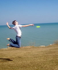 David Playing Frisbee (julieebeck) Tags: boy lake grass fun happy illinois jump jumping michigan lakemichigan toss frisbee northwestern leap throw lakefill