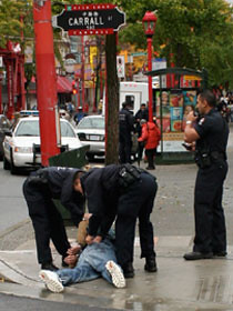 The Police arrest a suspected drug dealer on Carrall street near Pigeon Park.