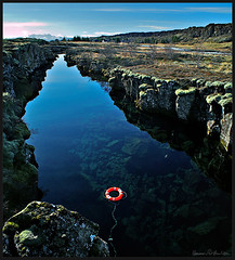 In cases of emergency (hauxon) Tags: red landscape iceland canyon thingvellir lifesaver