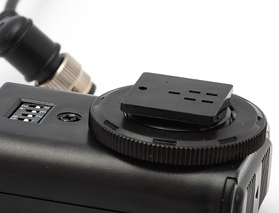 Adapter on the Phottix Cleon receiver for mounting on to a flash hotshoe