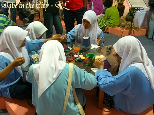 Students painting clay