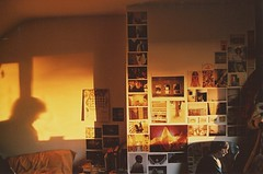 hard at work (Adele M. Reed) Tags: light boy sun film 35mm canon eos bedroom jon glow fuji working 200 postcards walls
