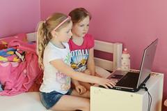 playing computer games (Helga Kristin photography) Tags: pink girls white cute smile hair spring nikon sweet laptop blonde age6 2011 age8 nikond7000