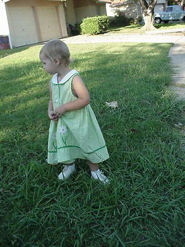 """9/14/03 Mom's having to deal with the life of a """"girly girl"""". We put some shorts and a T-shirt on her this morning, bu"""