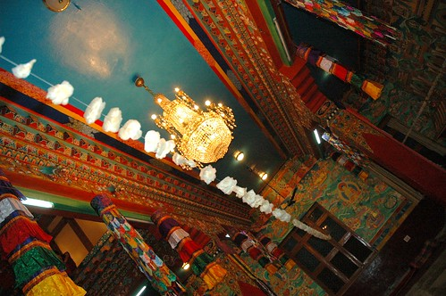A look at the ceiling of Tharlam Monastery, flower seed pod decorations, silk decorations, Buddha's life story mural, Sakya Lamdre, Bodha, Kathmandu, Nepal by Wonderlane