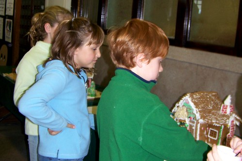 Caitlyn Sydney & Spencer looking at gingerbread houses