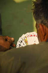 Whats your trump card (sanjayausta) Tags: poverty new portrait india playing cards countryside community asia village play hand faces digging refugee delhi indian country rustic poor tribal entertainment gandhi mines pakistani simple diggers camps handicrafts artisans nomads slum colony sanjay nagar villagers od tribals vagabonds ods bhatti ouds bhagirath nomatic