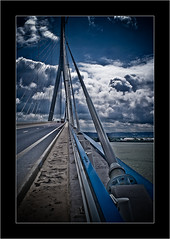 Pont de Normandie (Normandy Bridge) (Maciej - landscape.lu) Tags: bridge blue sky black france lines clouds composition de lomo flickr minolta dramatic explore adobe havre frame pont normandie konica february 2008 effect fr normandy hdr lr 2007 lightroom d7d clubfotoeu superbmasterpiece diamondclassphotographer flickrdiamond