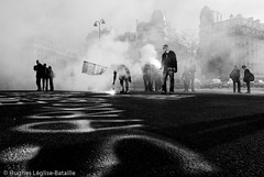 (Hughes Lglise-Bataille) Tags: blackandwhite bw paris france topf25 silhouette writing noiretblanc pavement nation protest photojournalism demonstration flare groundlevel manif manifestation 2007 retraite pensions retraites fumigene spciaux rgimes