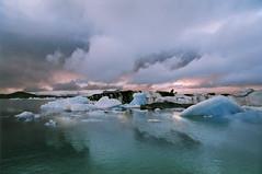 Jokulsarlon - Iceland (tigrić) Tags: blue autumn winter sky panorama lake reflection ice nature water clouds landscape iceland melting september glacier route1 jokulsarlon globalwarming jökulsárlón glacierlagoon