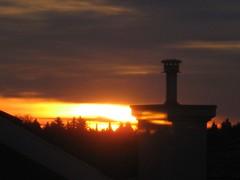 IMG_0621 (peggyhr) Tags: light chimney sky sun canada colour fall yellow clouds sunrise edmonton silhouettes alberta mauve oran 2007 rooflines peggyhr