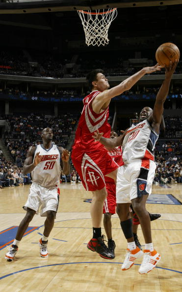 Yao Ming blocks a shot by Charlotte's Raymond Felton Sunday night where Yao recorded 3 rejections on the night.  But Yao did even more damage on the offensive end, hitting 13-of-15 shots and making 8-of-8 free throws to score a season-high 34 points.  He also grabbed 8 rebounds and dished 4 assists in the 85-82 victory.